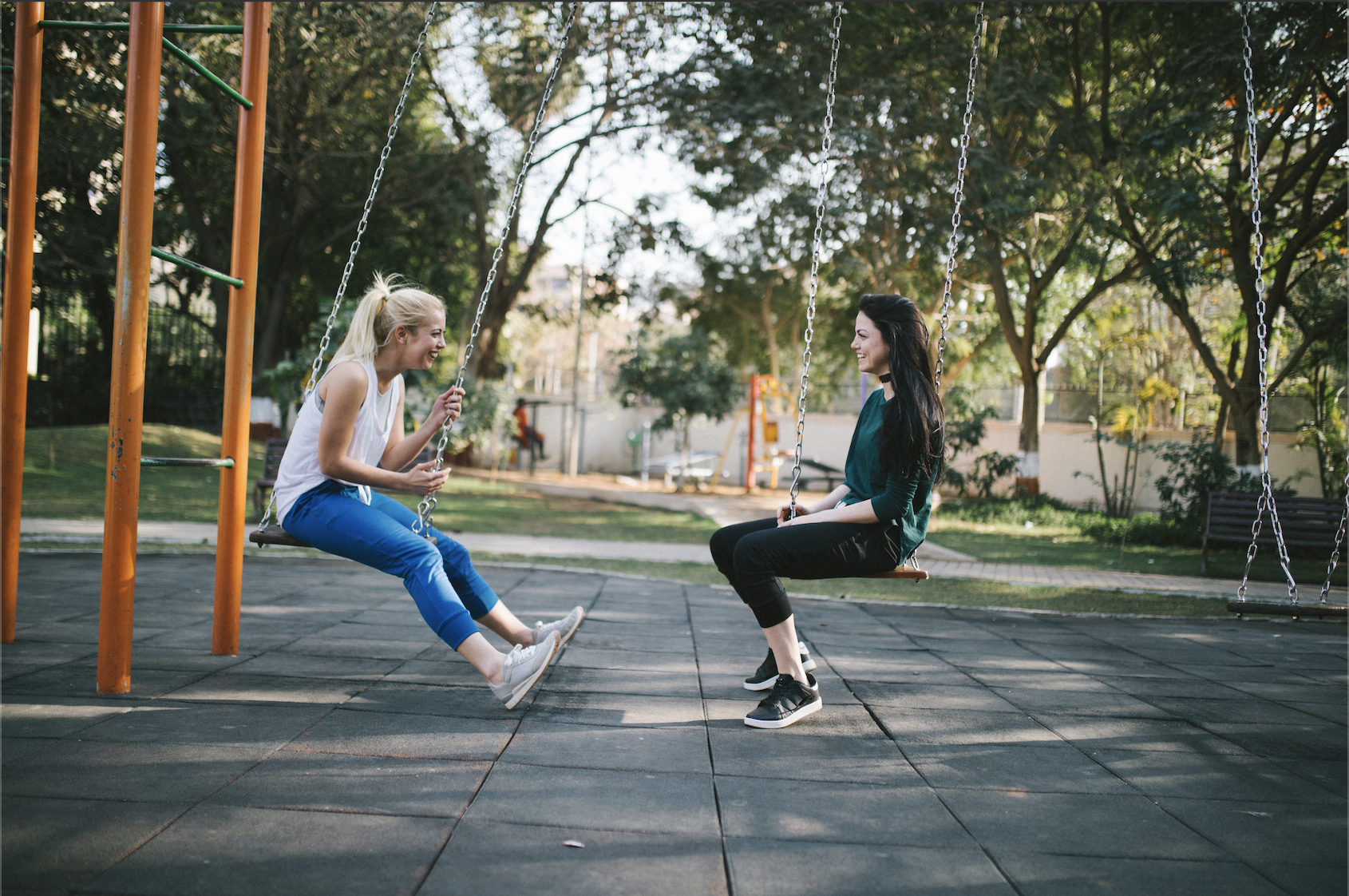 Teens talking on a playground
