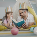 A father and daughter reading stories and playing make believe